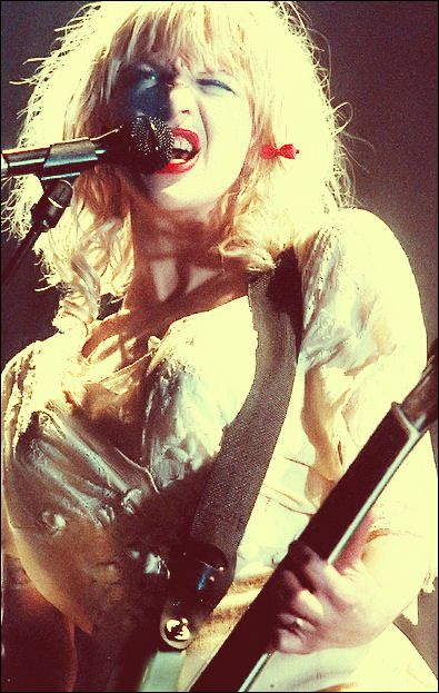 Courtney Love in her glory days. Goody barrettes. smeared matte red lipstick, peroxide-damaged hair