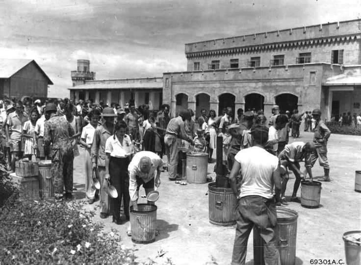 Feeding the liberated internees and prisoners of Bilibid...1945.