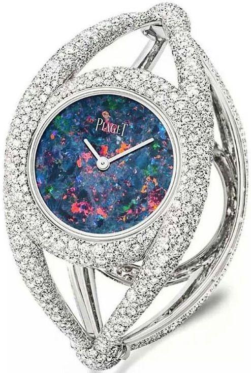 Piaget cuff watch, set with 1,699 brilliant-cut white diamonds surrounding an opal dial.