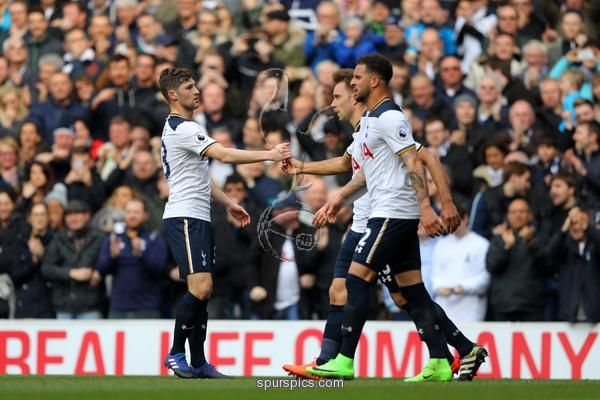 LONDON, ENGLAND - MARCH 19: Christian Eriksen of Tottenham Hotspur (R/obscure) celebrates scoring his sides wfirst goal ith Ben Davies of Tottenham Hotspur (L) during the Premier League match between Tottenham Hotspur and Southampton at White