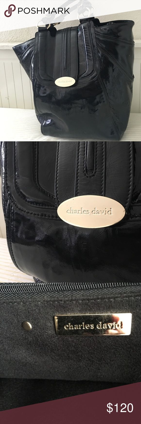 Charles David extra large patent leather handbag. This is a beautiful Charles David handbag is black patent leather on the exterior interior. Interior is black Felt cotton. Very large Beautiful handbag has gold hardware. also gently used in Great condition.... Charles David Bags Totes