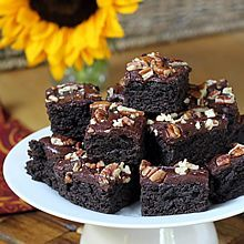 Dark Chocolate Zucchini Brownies. So moist & rich that no one will guess they're loaded with healthy veggies & whole grain. Recipe at TheYummyLife.com