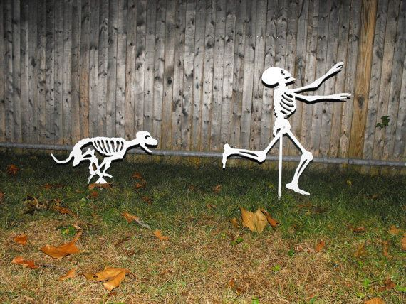 Halloween Yard Skeletons - dog skeleton chasing person skeleton -
