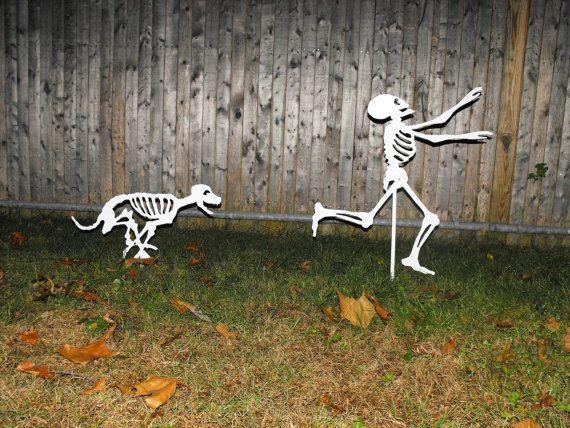 Halloween Yard Skeletons - dog skeleton chasing person skeleton -