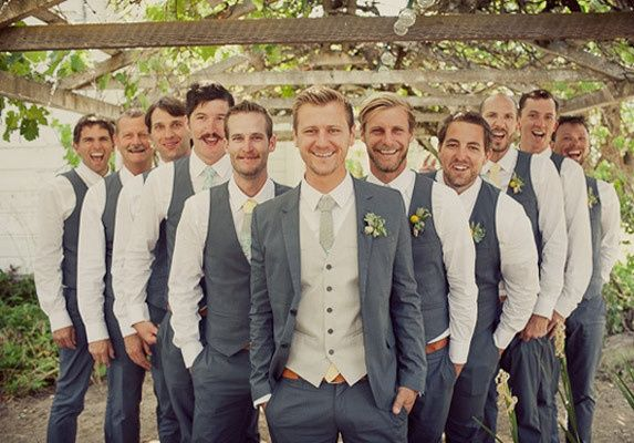 Sharp groom, best man, and groomsmen style for a classic, modern wedding party. Suit up your gentlemen in grey and white. Don't forget to match the boutonniere to the bride bouquet!