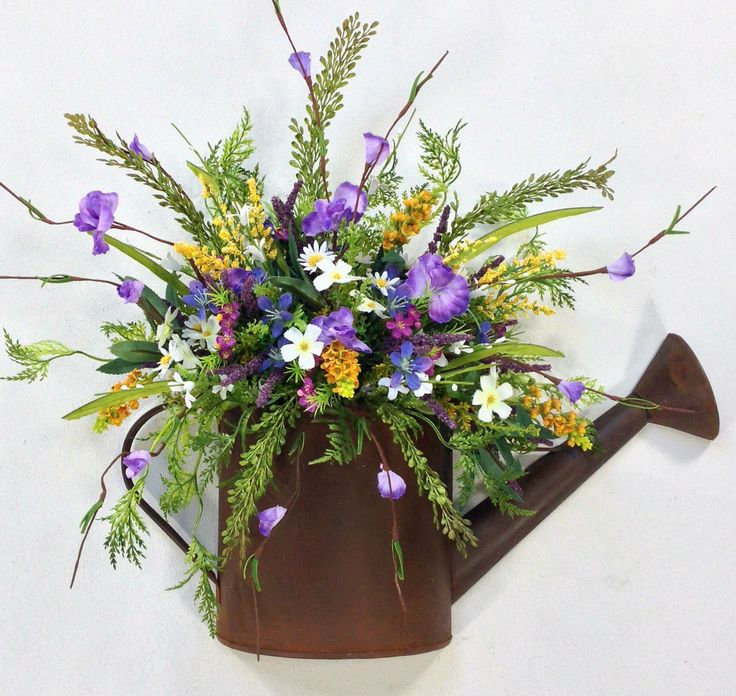 25 best ideas about watering can centerpieces on pinterest rustic centerpieces wedding vase - How to decorate with spring flowers ...