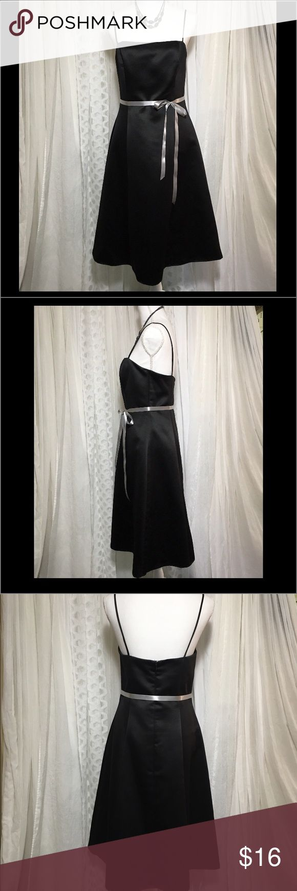 Jessica McClintock black size 10 dress Black dress size 10. This is a classic satin black dress with spaghetti straps. Has a few small snags on bottom front of dress, Inside lining has some discoloration and, front right strap shows the stitching in the inside is not visible when wearing see photo zips up the back.  Chest 16.5 inc Length 35 inc 100% polyester Fully lined. Hits me midcalf I'm 5'1. If you need a simple black dress for a bridesmaid, homecoming, choir this is a perfect dress. I…
