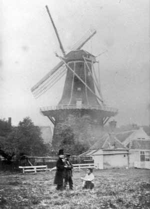 """Vincent van Gogh (with hat), visiting Dordrecht around 1876/1877. The windmill is identified as being """"De Oranjeboom"""" and was positioned at the corner of Burgemeester De Raadtsingel and Spuiweg before it was demolished in 1880-1882."""
