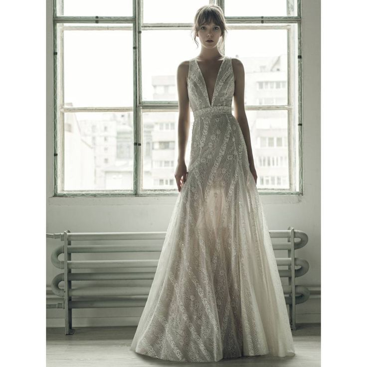 With a deep V illusion neckline, subtle sheer effect and a fit and flare silhouette that skims and flatters the figure, fw 2017 Millie wedding dress calls to the bride seeking a feminine, daring look.
