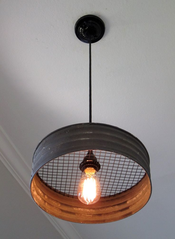 What a great light! Made with a grey corrugated metal that looks just like it came from an old farmhouse. This would make a great addition to a kitchen, laundry room, mudroom, barn, etc. The diameter
