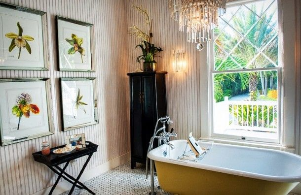 Bathroom - Stunning Tropical Yellow Bathtub Idea Mixed With Stainless Steel Faucet Installed In Cottage Bath With Floral Frames On Wall: Unique Bathtub Design Ideas for Suburban House