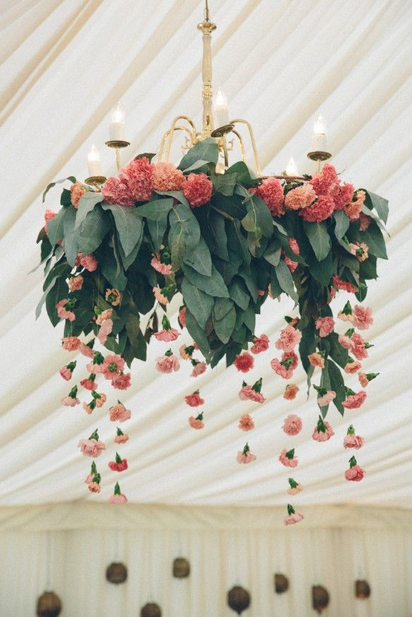 Beautiful floral chandelier at a wedding by luxury UK wedding planners Knot & Pop