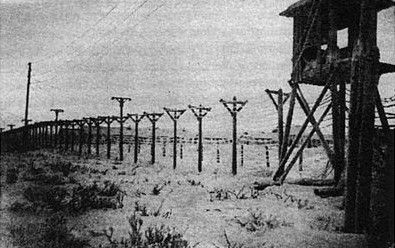 Fence and guard tower at Vorkuta Gulag work camp, Komi Republic, Russia, date…