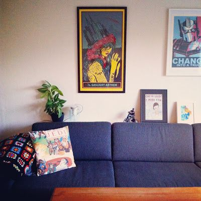 Sofa with shelf on top. Poster collage wall. From http://snaddersnadder.blogspot.no