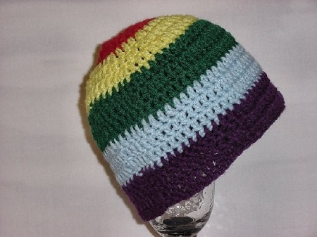 Gay Pride Rainbow Hat Crochet  rainbow colored hat crocheted in red, yellow, green, light blue and purple.