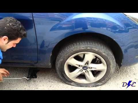 Cambiar rueda pinchada de coche - YouTube