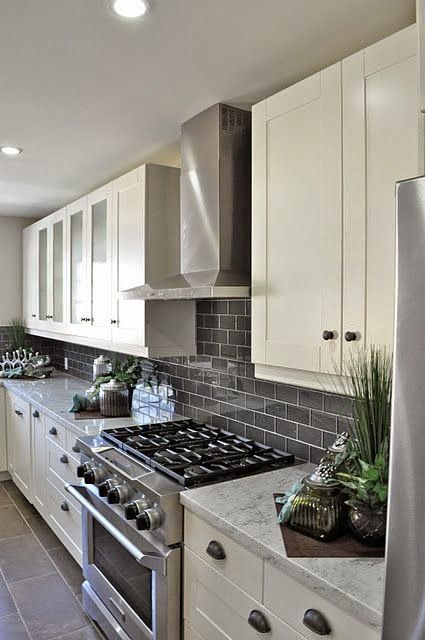 I'm Dreaming of a White..... Kitchen. Subway tiles, white cupboards, stainless appliances... I'm going nuts over neutral kitchens right now, guys.