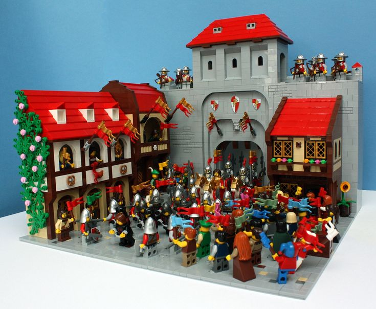 """Welcoming The King"" is an almost perfect Lego scene. You can almost hear the crowd. These classic Lego red roofs have never looked better."