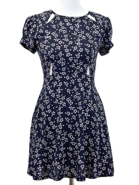 At once demure and daring with its classic silhouette and unexpected cut-outs, this lightweight, delicate floral print dress keeps things just east of Eden. - 100% Rayon - Hand wash - Imported - Style