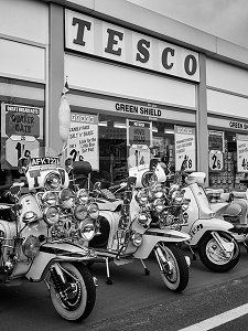 Scooters outside a Tesco store giving Green Shield Stamps.......very popular in the 60s.