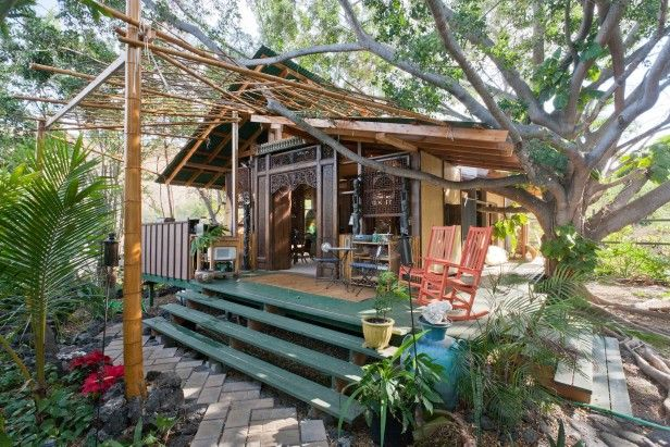Hawaiian Hideaway   Surfboards on the ceiling, dolphins in the bay and a tropical yard full of tiki torches and birds—wha...
