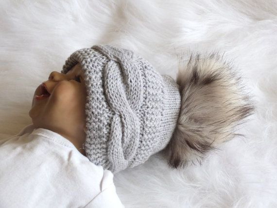 Knit hat in grey with faux fur pom pom  Hand by HandmadebyInese