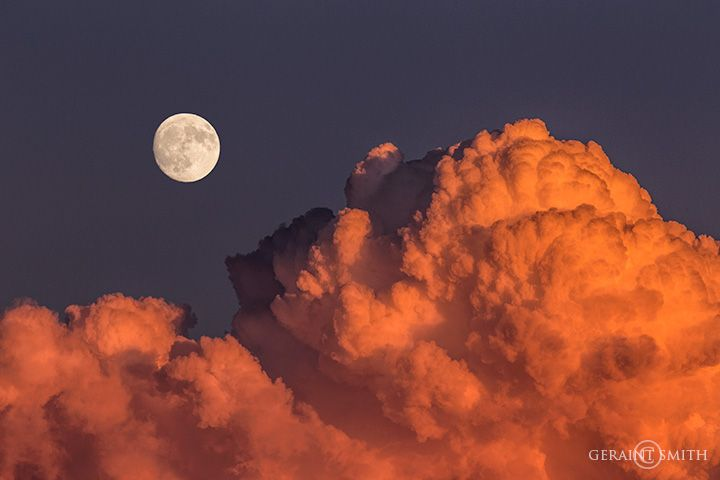 Sunset cloud and moonrise over the Sangre de Cristo Mountains