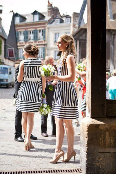 Striped bridesmaids dresses. Love these. via Style Me Pretty  Photography: One and Only Paris Photography Floral Design: Autrefois Deauville