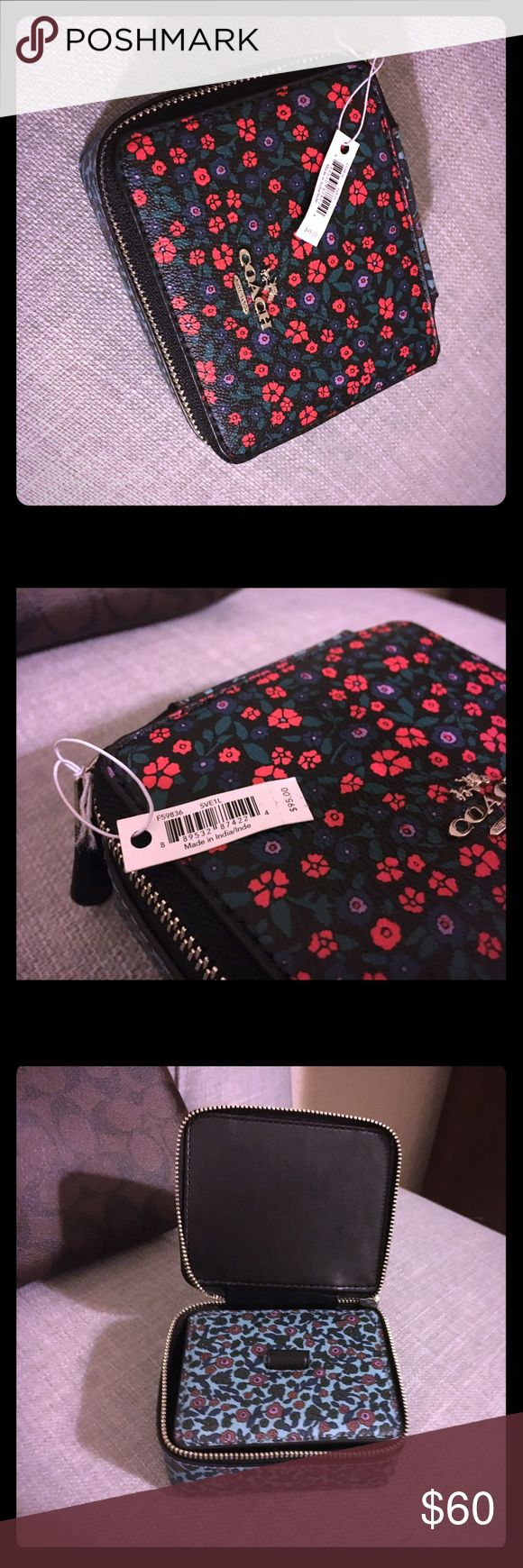 Coach travel jewelry bag flowers 2017 Coach travel jewelry bag flowers 2017, stylishly organize your jewelry during trips and keep your pieces secure.  Never used, NWT Coach Bags Travel Bags