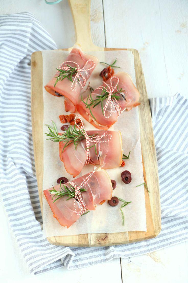 Kippendijen met rauwe ham uit de oven