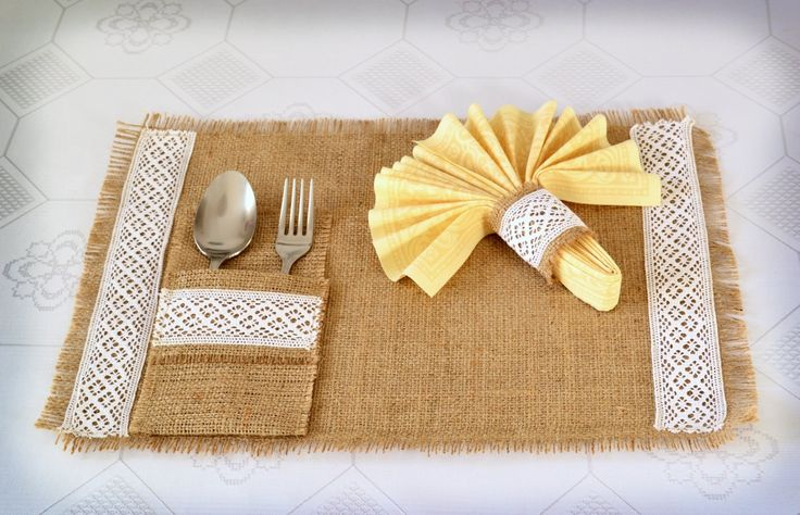 Burlap place mat, silverware pocket and napkin holder for rustic wedding table decorations, or French, country weddings. $20.00, via Etsy.
