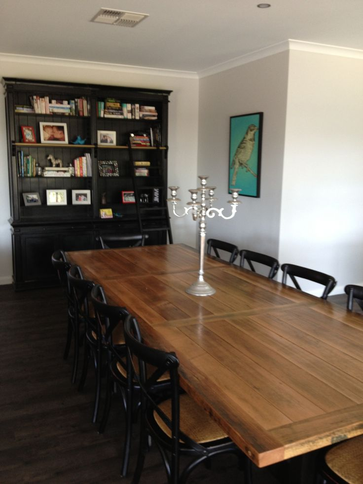 Dining table made from the old farmhouse floorboards and library from provincial living