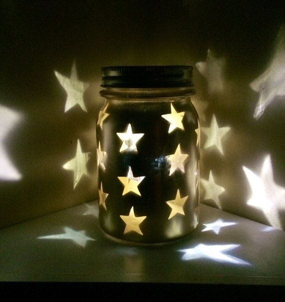 Gold Mason Jar luminary, Gold Lighted Star Jar, Gold Vintage Mason Jar, 50th Anniversary Decor, Golden Anniversary Decor, Vintage Metallic Gold Mason Jar with stars  Vintage heavy round bottom pint size Hazel Atlas packing Jar painted shimmering metallic gold with clear star stencil cut outs surrounding the exterior. A Gold Ball Star lid embellished with sparkling rhinestones crowns this beautiful piece of decor Lovely in daylight and stunning when darkness falls and an LED light inside the…