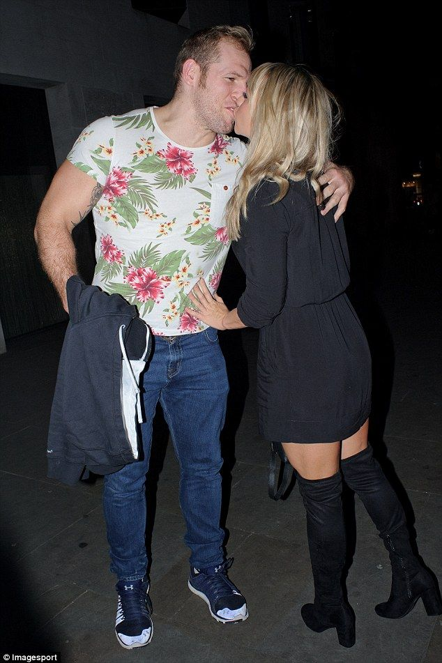 Loved-up: James Haskell, 31, and Chloe Madeley, 29, covered their washboard abs as they stepped out for a romantic dinner at STK in Covent Garden, London, on Wednesday night