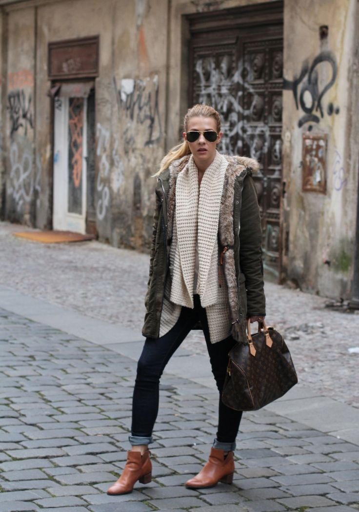 An olive green parka and navy blue slim jeans will showcase your sartorial self. Take a classic approach with the footwear and rock a pair of tobacco leather booties.   Shop this look on Lookastic: https://lookastic.com/women/looks/parka-open-cardigan-skinny-jeans/14933   — Black Sunglasses  — Beige Knit Open Cardigan  — Olive Parka  — Navy Skinny Jeans  — Dark Brown Print Leather Duffle Bag  — Tobacco Leather Ankle Boots