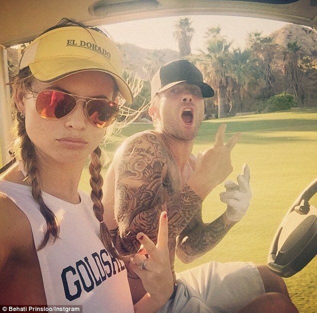 Golfing couple: The pair have just celebrated their one-year marriage anniversary, and have taken up golfing