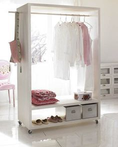 Portable closet - could make something like this pretty simple out of hollow core doors - need a closet for this room....