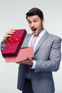 Business client opening chocolate gift received from company made by http://www.sayitwithchocolates.com/