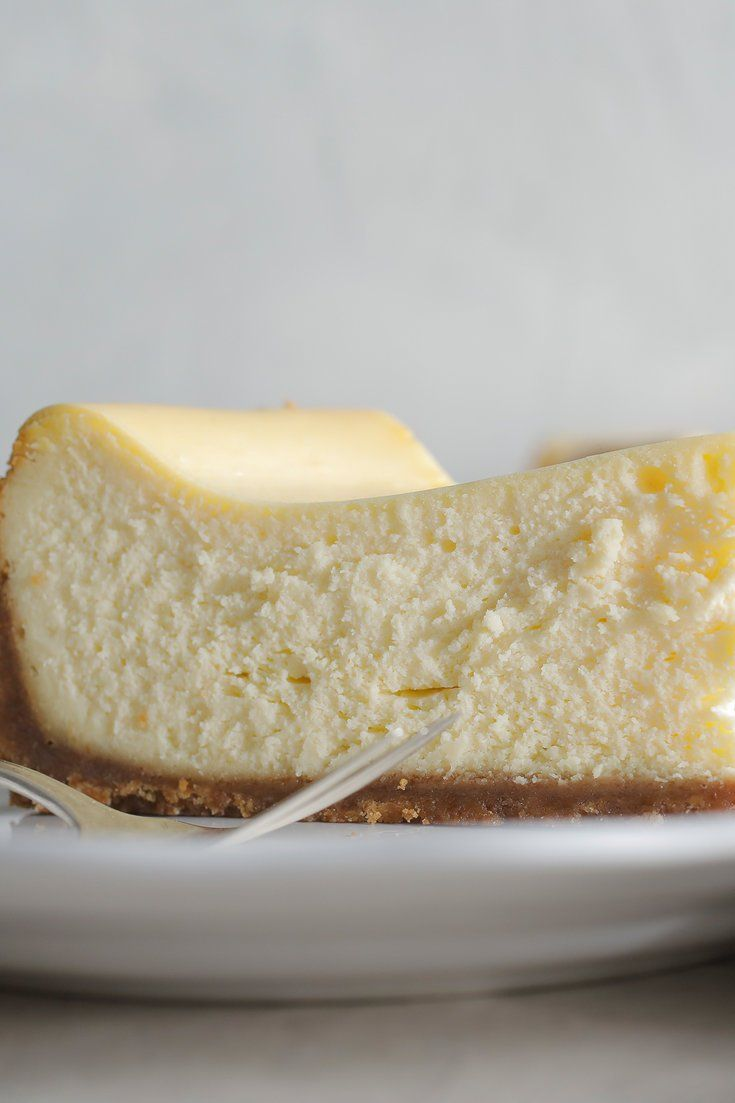 NYT Cooking: If there's one dessert that would least  benefit from innovation, it would have to be New York-style cheesecake. No tricks, no twists; Just a crumbly graham cracker crust and lots of lightly sweetened cream cheese. Baking a cheesecake without a water bath might seem like you're tempting fate, but if you do so at a low enough temperature, it will cook the filling gently and evenly without the ri...