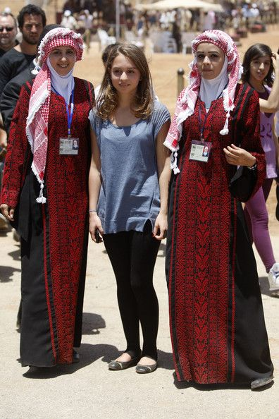 Princess Iman (C), daughter of King Abdullah, with Jordanian women in traditional dress of the Jordanian Int'l Horseback Archery competition on June 10, 2011