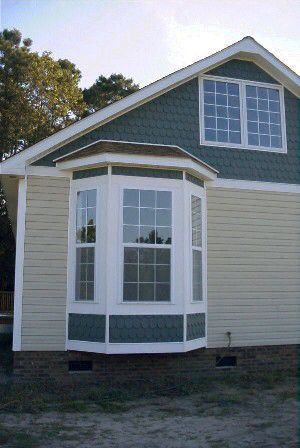 Exterior treatment for a bay window home design for Bay window exterior designs