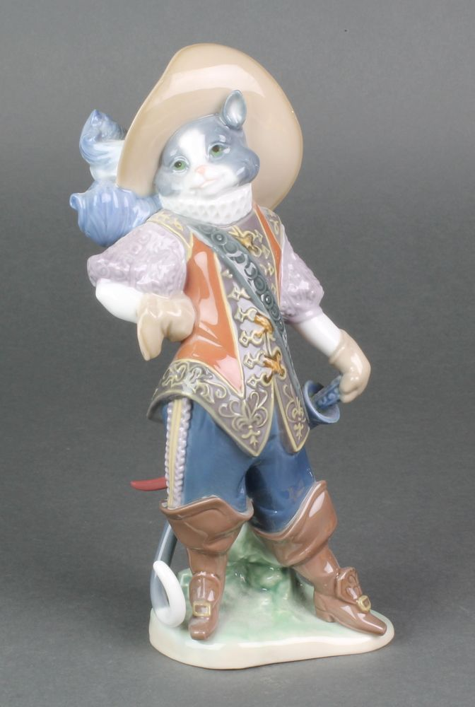 """Lot 81, A Lladro figure of Puss in Boots 8599 8 1/2"""", sold for £140"""