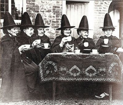 Welsh women in traditional dress with tall, witch type hats.