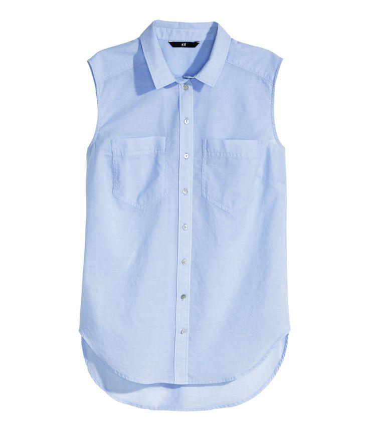 Light blue sleeveless shirt with chest pockets, collar ...
