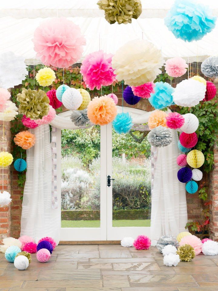 Party decoration pompoms - try hanging with Command(TM) Party Ceiling Hooks.