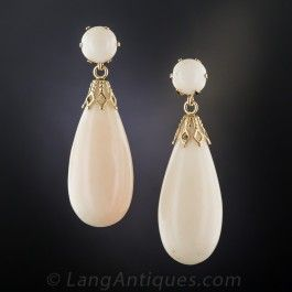 Ivory with just the faintest hint of pink, sizable (over 1 1/2 inches long), ear drops of white angel skin corals. (This particular angel must have used lots of sunblock.) Disappearing ocean gems presented in 14K gold.