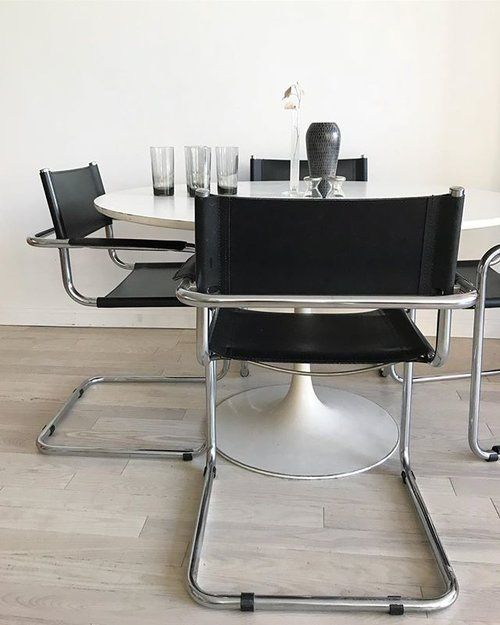 Keeping in cool 😎. 1970s Made in Italy black leather and chrome cantilever chairs, $500 per pair (4 pairs total). • 1960s Burke white round tulip table, $900. 〰〰〰 #martstam #madeinitaly #blackandwhite #1960s #1970s #retro#classic #timeless #bauhaus #diningroom #tuliptable #homeunion #brooklyn #nyc #williamsburg #furnitureshop #furnituredesign #cantilever #minimal #design