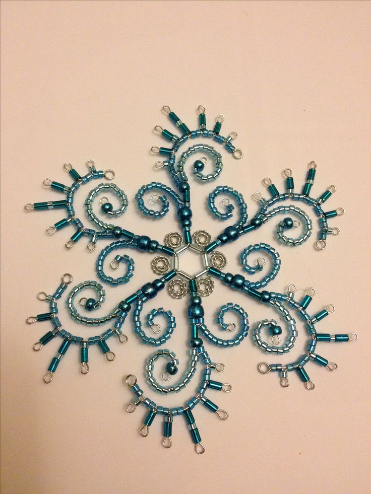 Hand beaded snowflake ornament  I like the pattern to embellish plain space on quilt