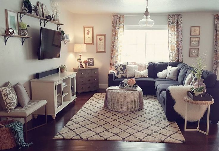 Dark gray couch. Light gray walls.
