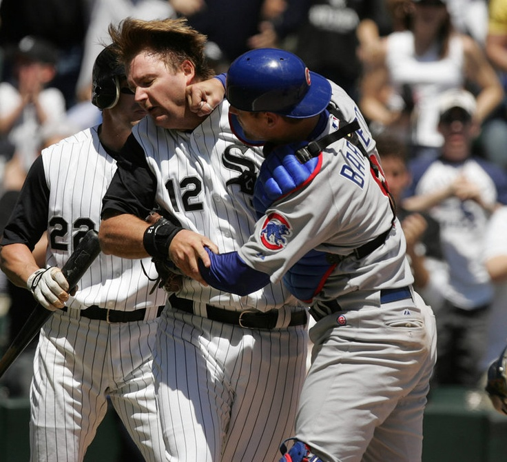 Chicago Cubs' Michael Barrett, right, punches White Sox A.J. Pierzynski after Pierzynski plowed into the Cubs catcher at home plate in the second inning during their interleague game at US Cellular Field.